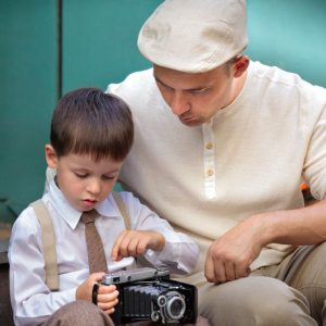 14965477 - young father and son outdoors with retro camera on their hands